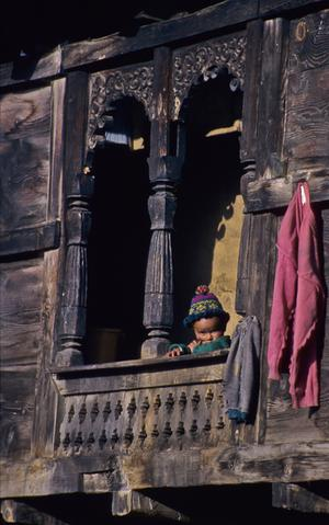 Child at a window in Kalpa, Northern India (2000) Photo (c) Karen Abrahamson