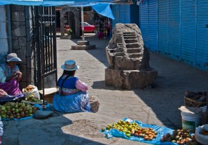 Market Scene, Chivay. Note the Inca rock that shows terracing and irrigation techniques. (2011) Photo (c) Karen Abrahamson