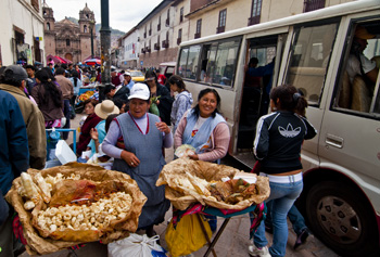 Working together to sell pork rinds outside Cusco mercado (2011) Photo (c) Karen Abrahamson